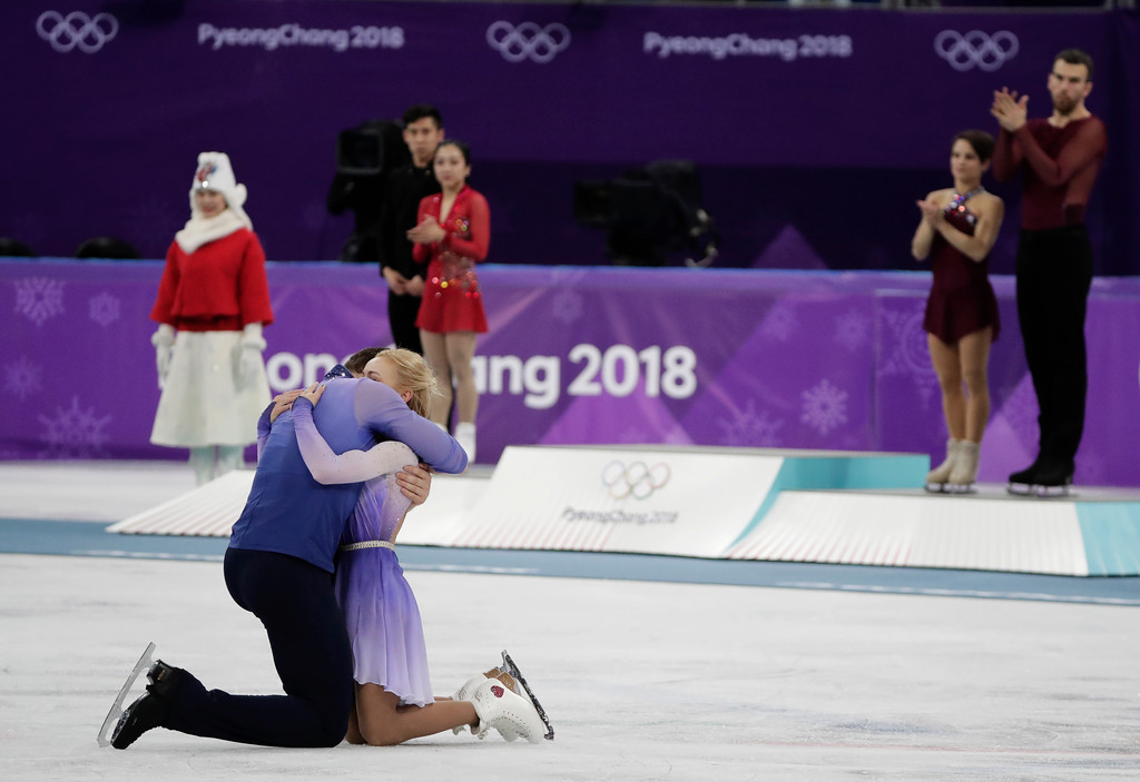 . Aljona Savchenko and Bruno Massot of Germany embrace as they celebrate during the venue ceremony after winning the gold medal in the pairs free skate figure skating final in the Gangneung Ice Arena at the 2018 Winter Olympics in Gangneung, South Korea, Thursday, Feb. 15, 2018. (AP Photo/Julie Jacobson)
