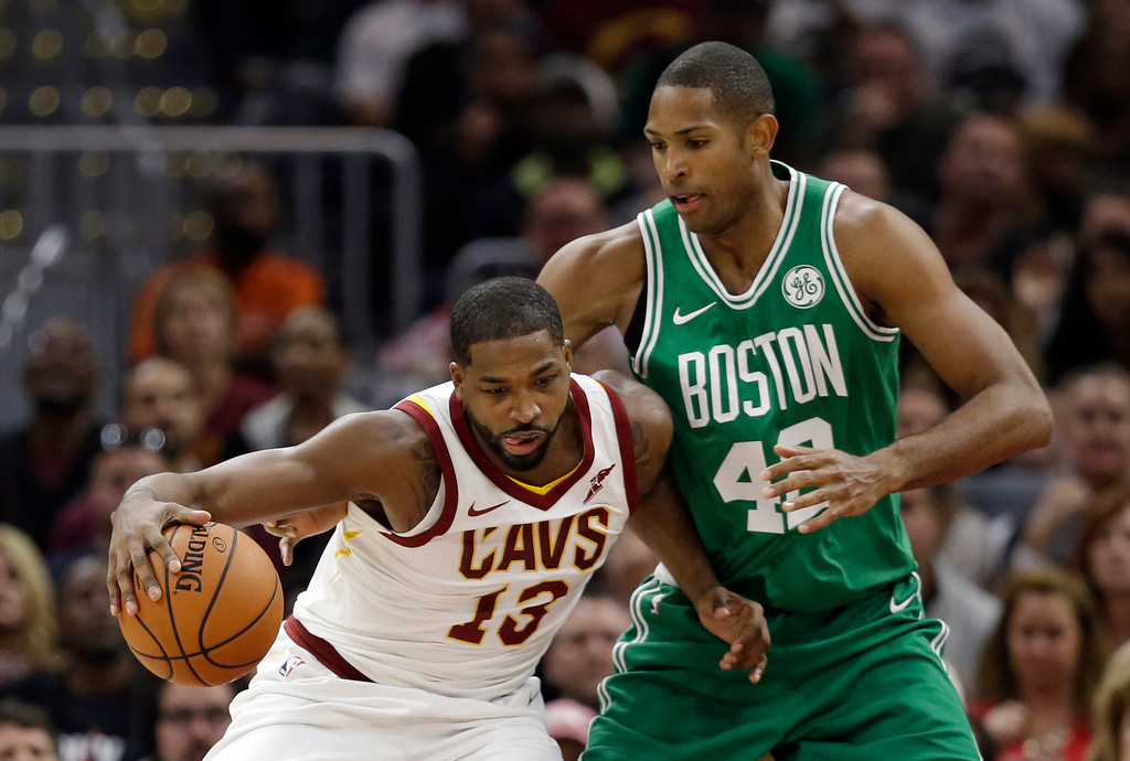 . Cleveland Cavaliers\' Tristan Thompson (13) drives past Boston Celtics\' Al Horford (42), from Dominican Republic, in the first half of an NBA basketball game, Tuesday, Oct. 17, 2017, in Cleveland. (AP Photo/Tony Dejak)