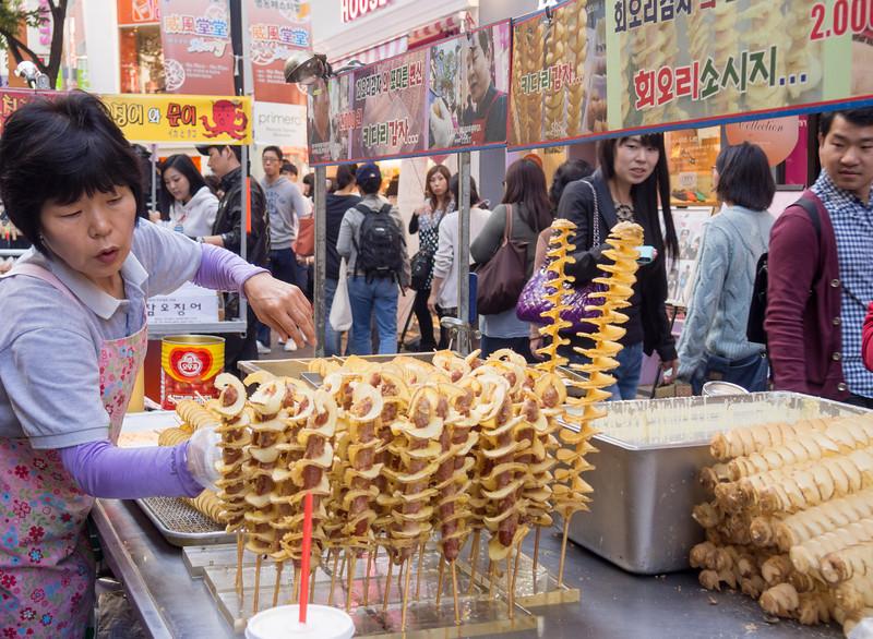 Curly potato crisps are quite popular. Myeongdong, Seoul