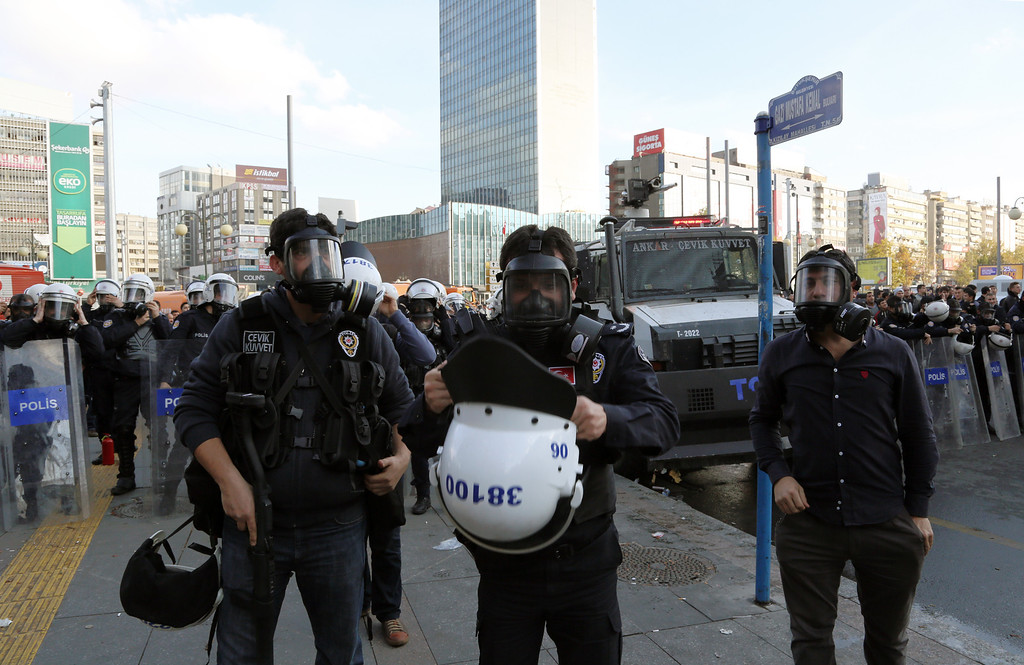 . Riot police prepare before they use water cannons and pepper gas to disperse thousands of Turkish teachers who were gathered to protest against the government\'s education and economic policies in Ankara, Turkey, Saturday, Nov. 23, 2013.(AP Photo/Burhan Ozbilici)
