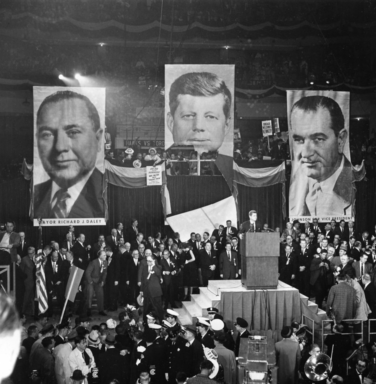 . Kennedy speaks to supporters as he stands with his sister, Eunice Shriver, looking back, Chicago Mayor Richard J. Daley, center, and Otto Kerner, Democratic candidate for Illinois governor, at Chicago Stadium in Chicago.   Associated Press file, File