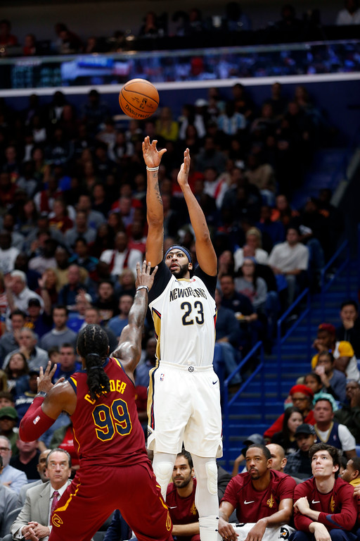 . New Orleans Pelicans forward Anthony Davis (23) shoots over Cleveland Cavaliers forward Jae Crowder (99) in the second half of an NBA basketball game in New Orleans, Saturday, Oct. 28, 2017. The Pelicans won 123-101. (AP Photo/Gerald Herbert)