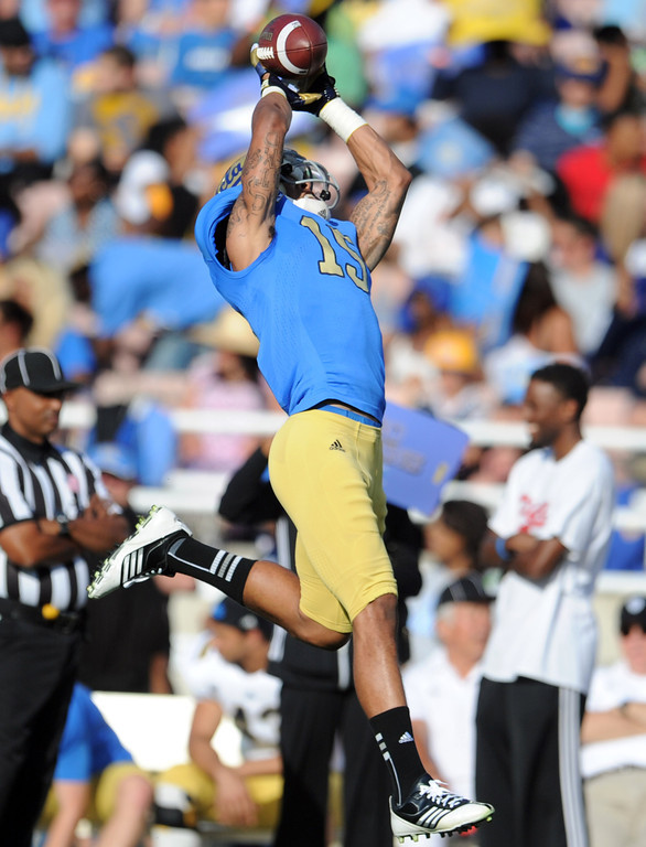 . UCLA wide receiver Devin Lucien (15) catches a pass during the football spring showcase college football game in the Rose Bowl on Saturday, April 27, 2013 in Pasadena, Calif.    (Keith Birmingham Pasadena Star-News)