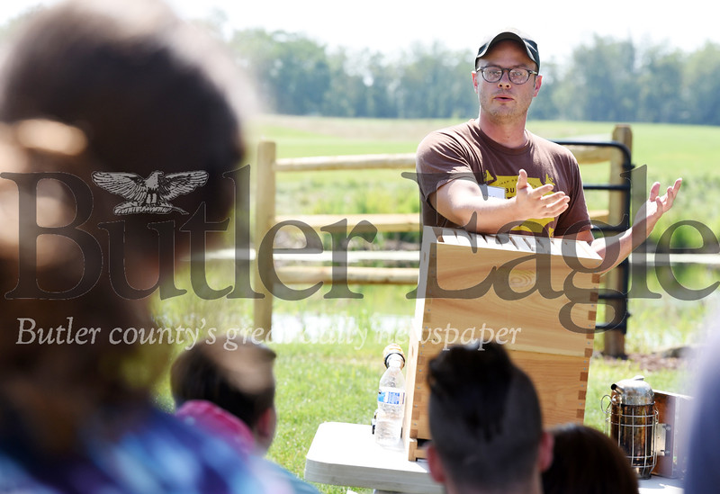 Harold Aughton/Butler Eagle: Kyle Pattison of Burgh Bees explains the history of the bee hive to about 30 people Saturday, July 27, 2019.