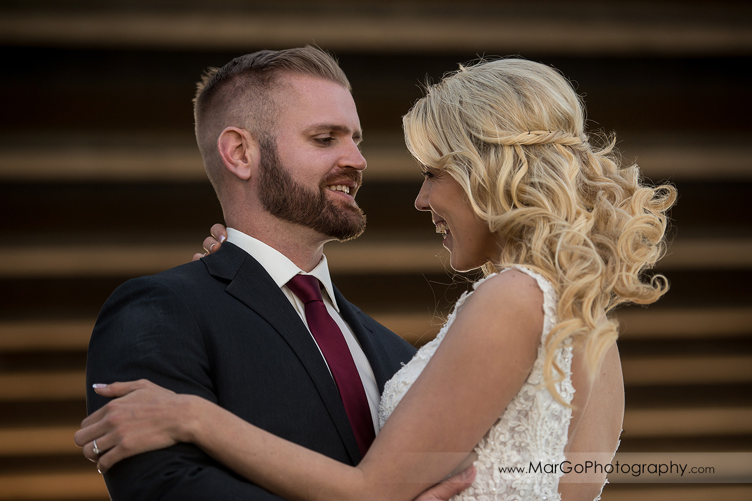 portrait of bride and groom looking at each other at San Diego Mission Bay Park