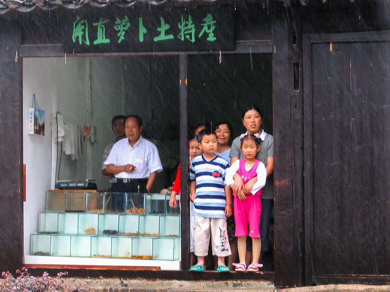 Waiting out the rain in Souchou, China, 2004