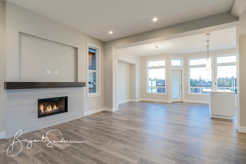 Interior of a modern living room with hardwood floors and fireplace.