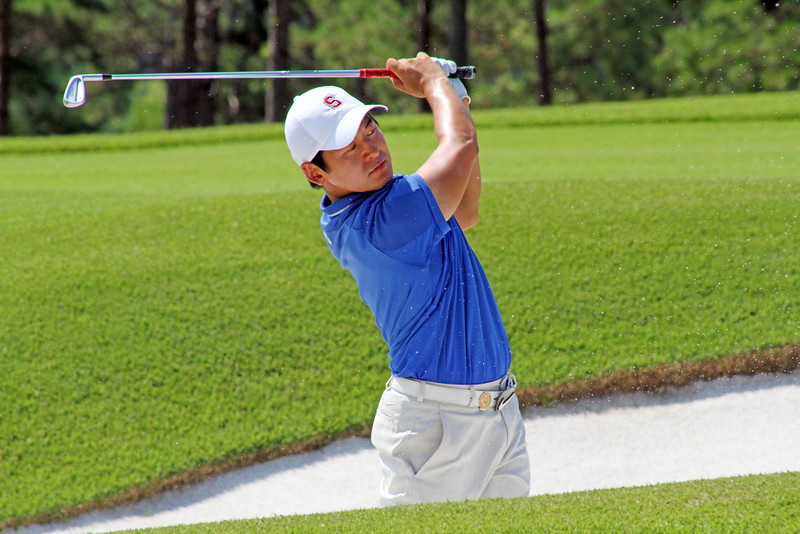 Andrew Yun of Chandler, AZ successfully escapes from a fairway bunker during the second round of the 111th Western Amateur at The Alotian Club in Roland, AR. (WGA Photo/Ian Yelton)