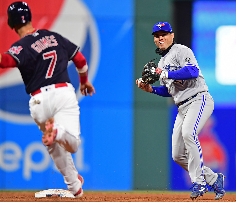 . Toronto Blue Jays\' Aledmys Diaz gets Cleveland Indians\' Yan Gomes out at second base and throws to first base in the eighth inning of a baseball game, Friday, April 13, 2018, in Cleveland. Rajai Davis was out at first base for the double play. The Blue Jays won 8-4. (AP Photo/David Dermer)