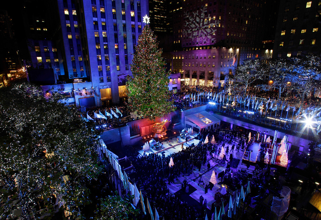 . Crowds gather as the Rockefeller Center Christmas Tree is lit during the 80th annual tree lighting ceremony at Rockefeller Center in New York, Wednesday, Nov. 28, 2012. (AP Photo/Kathy Willens)