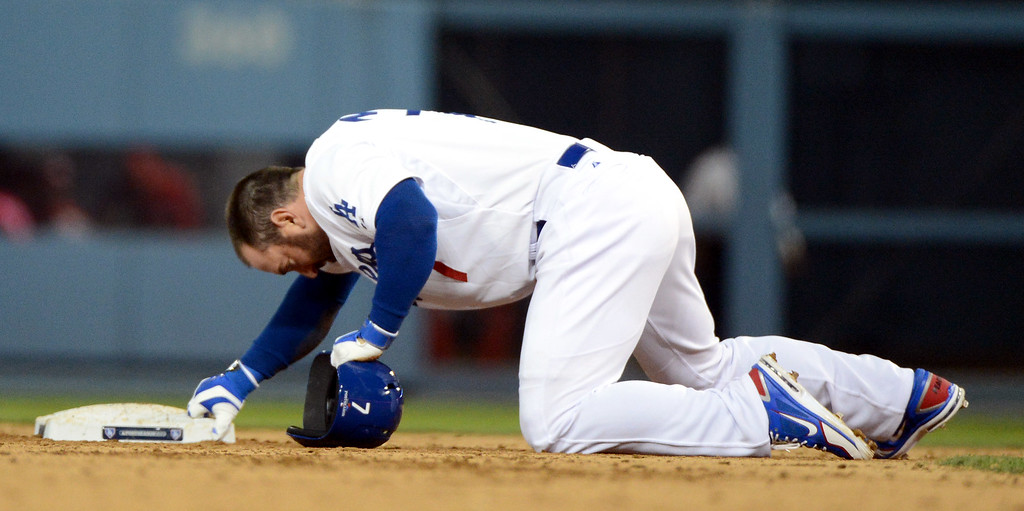 . Los Angeles Dodgers\' Nick Punto reacts after being picked off at second base in the seventh during the NLCS at Dodger Stadium against the St. Louis Cardinals Tuesday, October 15, 2013. (Photo by David Crane/Los Angeles Daily News)