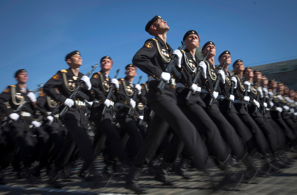 . Russian marines march through the Red Square, during the Victory Day Parade, which commemorates the 1945 defeat of Nazi Germany in Moscow,  Russia, Thursday, May 9, 2013. Russian President Vladimir Putin has said at the annual military parade on Red Square that Russia will be a guarantor of world security. Putin\'s short speech Thursday came at the culmination of Victory Day, marking the defeat of Nazi Germany 68 years ago. It is Russia\'s most important secular holiday, honouring the huge military and civilian losses of World War II and showing off the country\'s modern arsenal. (AP Photo/Alexander Zemlianichenko)
