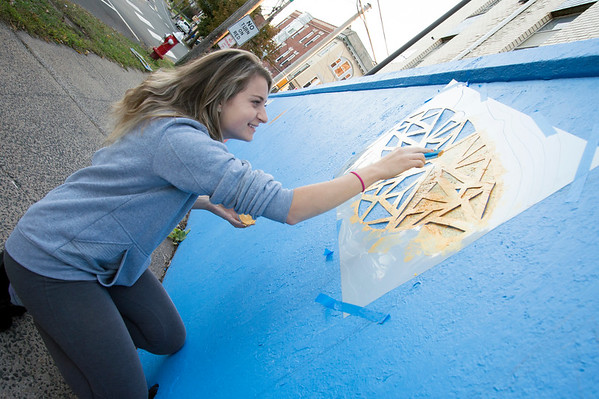 10/15/19 Wesley Bunnell | StaffrrCCSU art students spent part of Tuesday painting on East St near East Main St as part of a course called Art in Community taught by art professor Ted Efremoff. Student Danielle Pelkowski of New Britain helps with the painting.