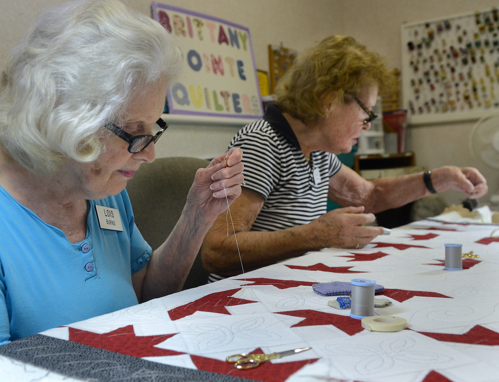 . Brittany Pointe Quilter Lois Burns (L) and members work on quilts for this years holiday season at Brittany Pointe Estates in Upper Gwynedd on Tuesday August 8,2014. Photo by Mark C Psoras/The Reporter