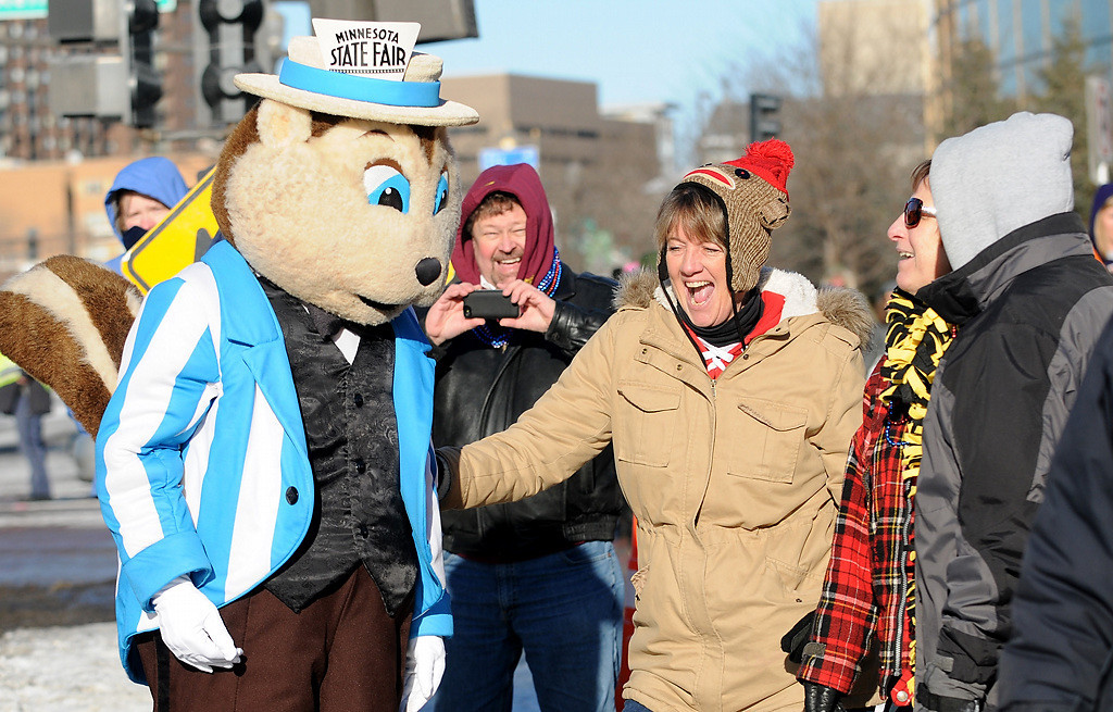 . A gopher from the Minnesota State Fair dances with parade-goers at the Winter Carnival Grande Day Parade in St. Paul, Saturday January 25, 2014.  (Pioneer Press: Jean Pieri)