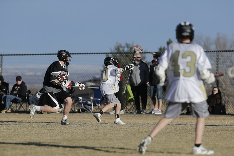 JPM0294-JPM0294-Jonathan first HS lacrosse game March 9th.jpg