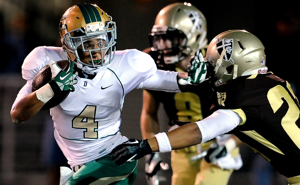 . Damien\'s Leroy Cloud (4) runs for yardage before fumbling against St. Francis in the first half of a prep football game at St. Francis High School in La Canada, Calif., Friday, Sept. 27, 2013.   (Keith Birmingham Pasadena Star-News)
