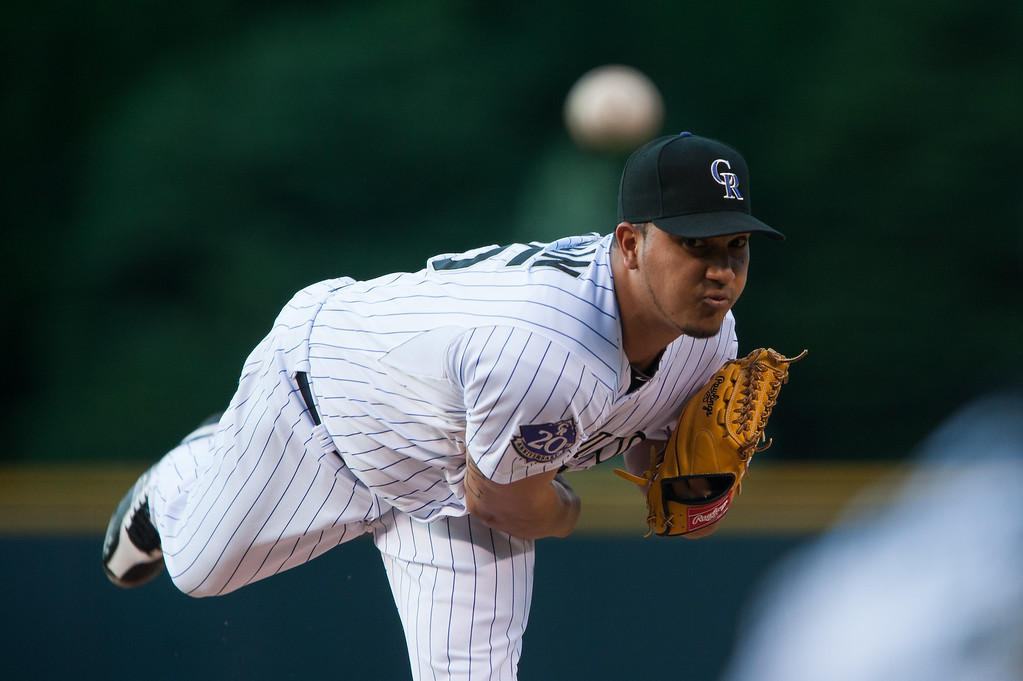 . Jhoulys Chacin #45 of the Colorado Rockies delivers a pitch in the first inning of a game against the San Diego Padres at Coors Field on June 6, 2013 in Denver, Colorado. (Photo by Dustin Bradford/Getty Images)