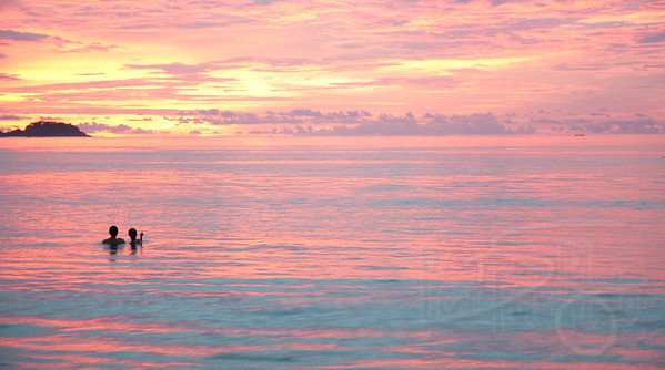 Evening swim. Patong Beach. Phuket, Thailand