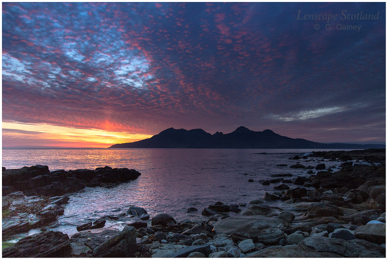 sunset over the Isle of Rhum, from Laig Bay on the Isle of Eigg
