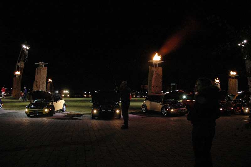 """Burning Stones and a few MINIs providing a """"light show."""" With the bonnets raised, the MINI's lights shine straight up, toward the heavens and the mother ship."""