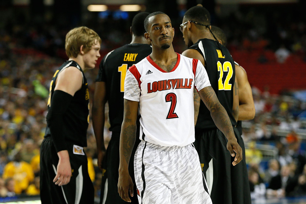 . ATLANTA, GA - APRIL 06:  Russ Smith #2 of the Louisville Cardinals reacts in the first half as the Wichita State Shockers huddle during the 2013 NCAA Men\'s Final Four Semifinal at the Georgia Dome on April 6, 2013 in Atlanta, Georgia.  (Photo by Kevin C. Cox/Getty Images)