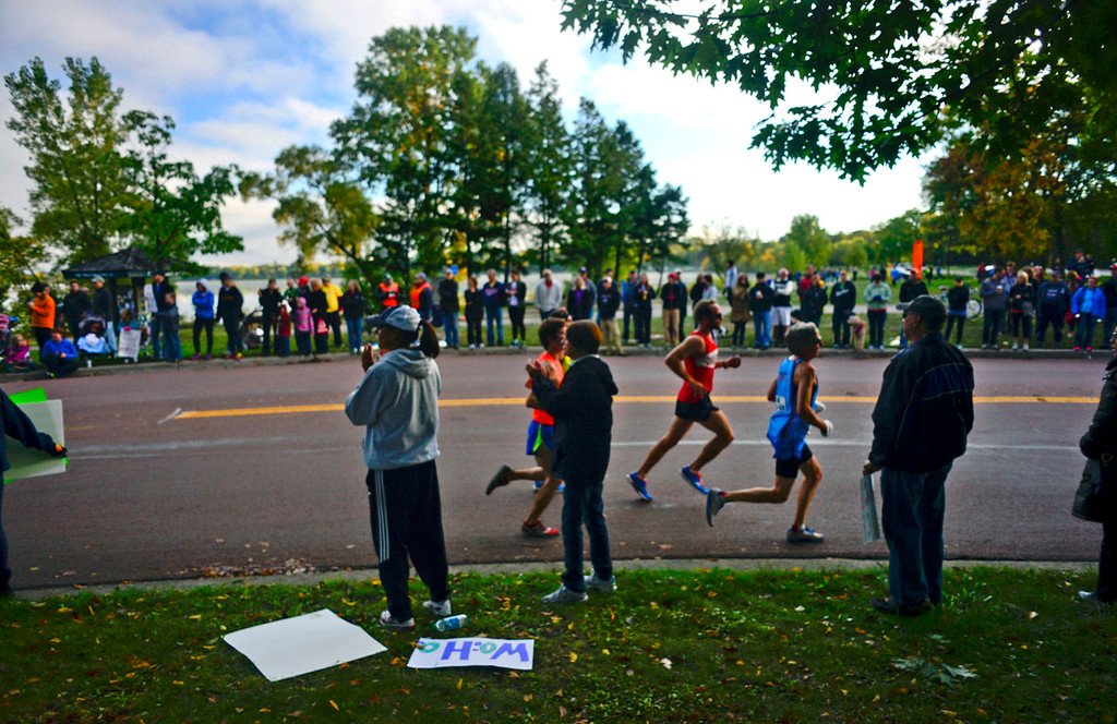 . A portion of the nearly 12,000 registered runners passes by spectators near Lake Calhoun in Minneapolis. (Pioneer Press: Simon Guerra)