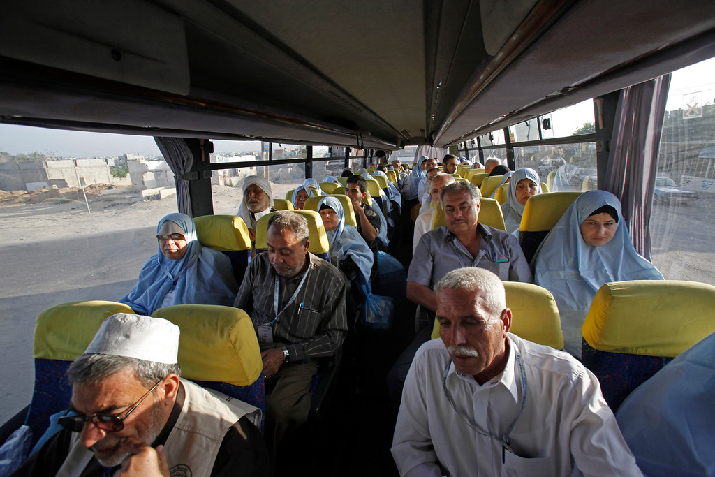 . Palestinian Muslim pilgrims wait inside a bus en route to Rafah border between Gaza Strip and Egypt before leaving for the annual hajj pilgrimage to the holy city of Mecca, in Gaza City, early Wednesday, Oct. 2, 2013. Hundreds of Palestinian pilgrims are leaving Gaza through the Rafah border crossing with Egypt on their way to Mecca, Saudi Arabia, for hajj. Egypt has agreed to keep the crossing open for three days to allow thousands of people to cross, heading to the Cairo International Airport. (AP Photo/Adel Hana)