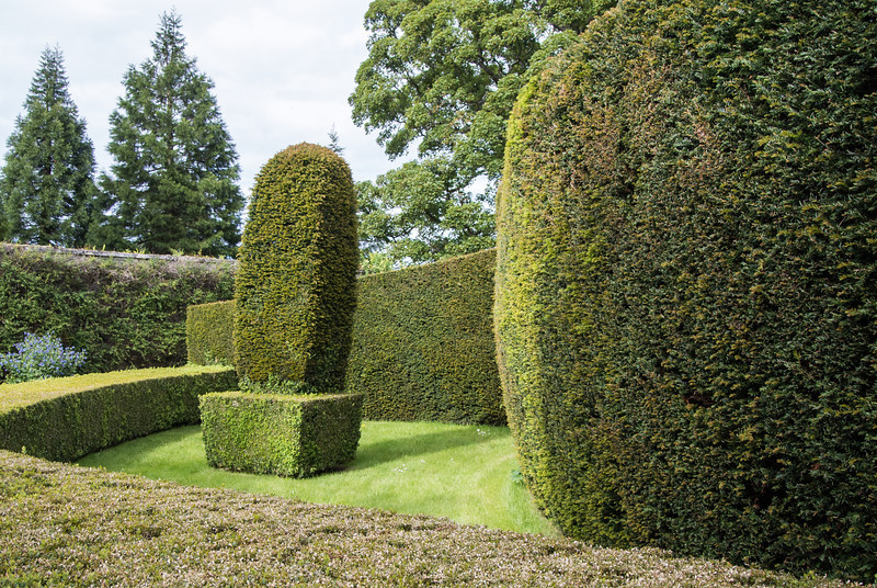The castle had acres of well kept gardens.