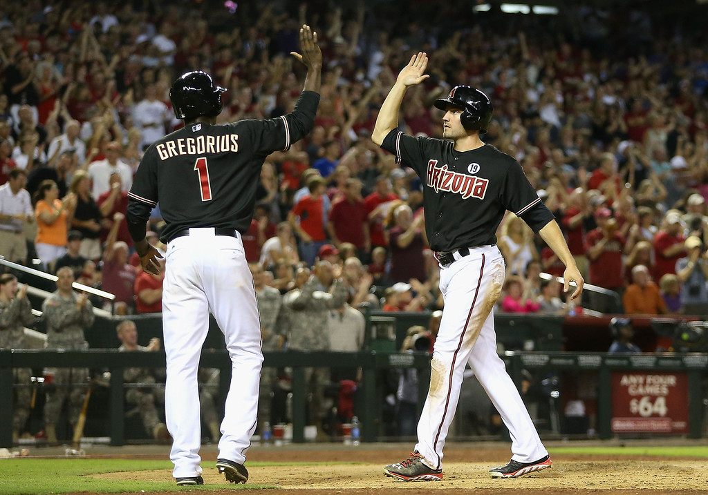 . PHOENIX, AZ - JULY 05:  A.J. Pollock #11 of the Arizona Diamondbacks high fives Didi Gregorius #1 after scoring against the Colorado Rockies during the seventh inning of the MLB game at Chase Field on July 5, 2013 in Phoenix, Arizona.  (Photo by Christian Petersen/Getty Images)