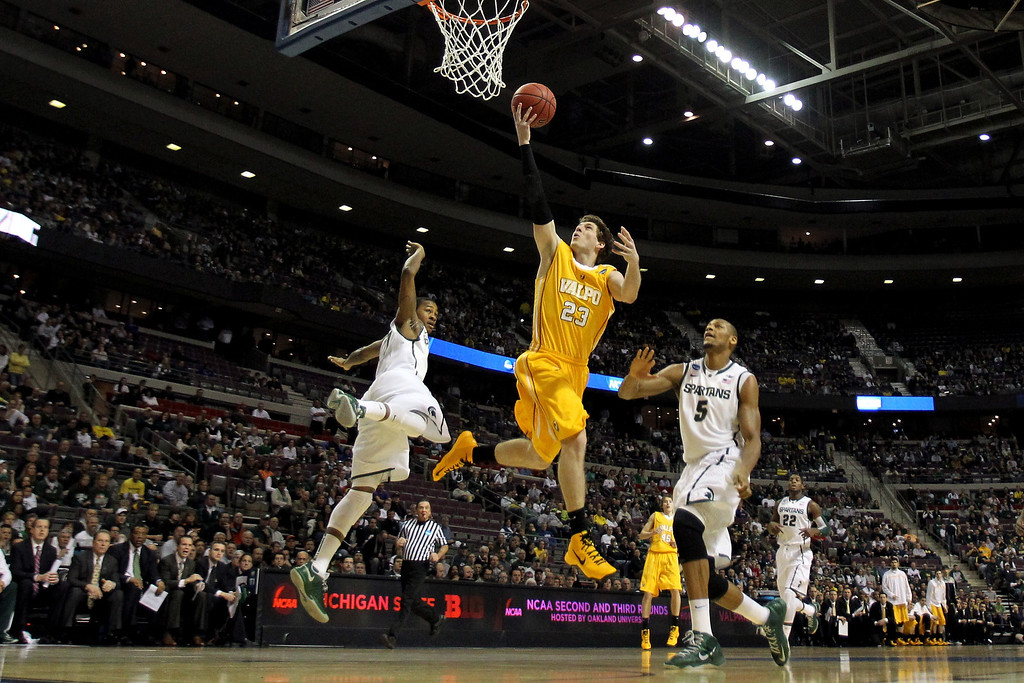 . Matt Kenney #23 of the Valparaiso Crusaders drives for a shot attempt in the first half against Adreian Payne #5 of the Michigan State Spartans during the second round of the 2013 NCAA Men\'s Basketball Tournament at at The Palace of Auburn Hills on March 21, 2013 in Auburn Hills, Michigan.  (Photo by Jonathan Daniel/Getty Images)
