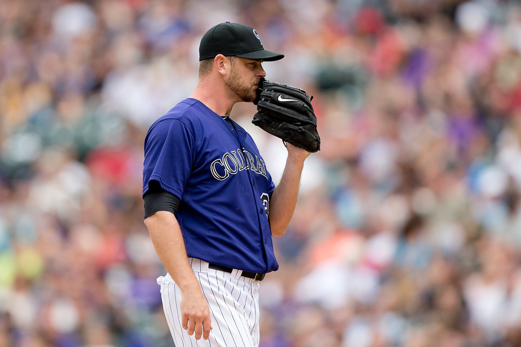 . DENVER, CO - JUNE 7:  Relief pitcher Nick Masset #37 of the Colorado Rockies reacts after giving up a go-ahead three run home run to Tim Federowicz (not pictured) of the Los Angeles Dodgers during the seventh inning at Coors Field on June 7, 2014 in Denver, Colorado. The Rockies defeated the Dodgers 5-4 in 10 innings to end their eight game losing streak. (Photo by Justin Edmonds/Getty Images)