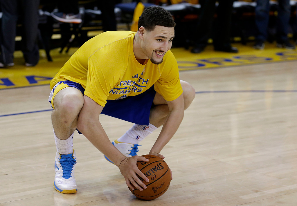 . Golden State Warriors guard Klay Thompson smiles while warming up before Game 1 of basketball\'s NBA Finals against the Cleveland Cavaliers in Oakland, Calif., Thursday, June 4, 2015. (AP Photo/Ben Margot)