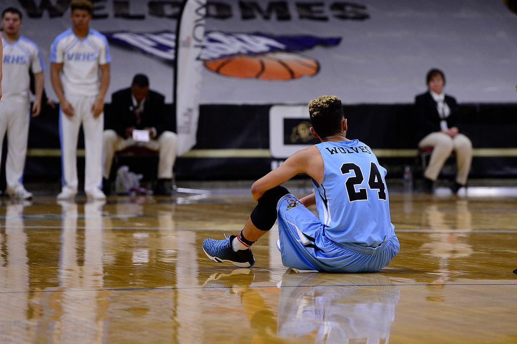 . Hunter Maldonado (24) of Vista Ridge sits on the floor after being fouled out of the game at the Coors Events Center on March 11, 2016 in Boulder, Colorado. Maldonado scored 35 points. Pueblo West defeated Vista Ridge 65-54 to advance to the 4A finals of Colorado state basketball tournament.  (Photo by Brent Lewis/The Denver Post)
