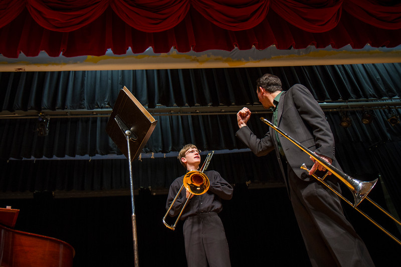 Adjudicator Tony Hammond demonstrates some playing techniques after Great Falls High's Connor Dennis' performance at the 2015 MHSA District 6 Music Festival.