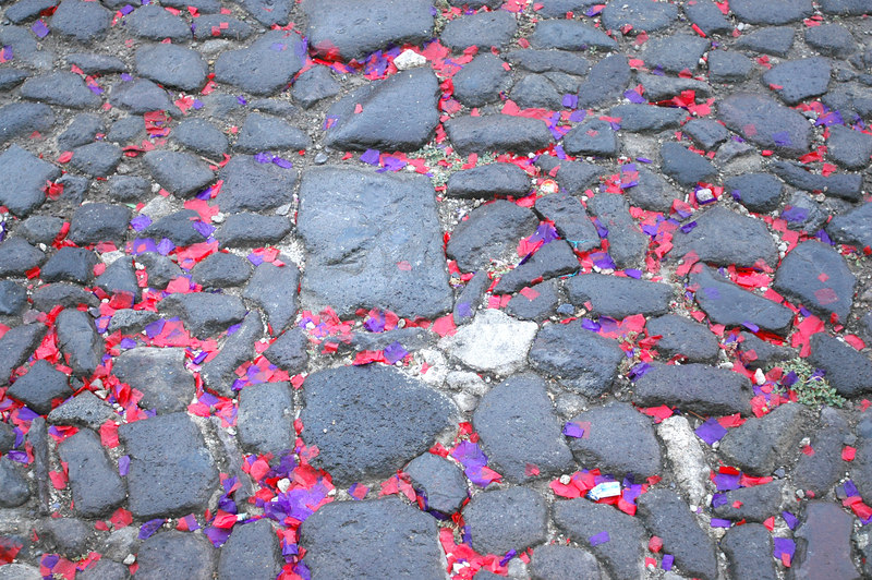 Confetti littered the streets of Antigua after the daily religious processions.  All over town, you could hear them coming from the somber music echoing through the streets.
