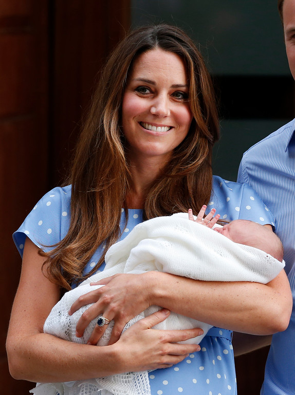 . Kate, Duchess of Cambridge holds the Prince of Cambridge, Tuesday July 23, 2013, as she poses for photographers outside St. Mary\'s Hospital exclusive Lindo Wing in London where the Duchess gave birth on Monday July 22.  (AP Photo/Lefteris Pitarakis)
