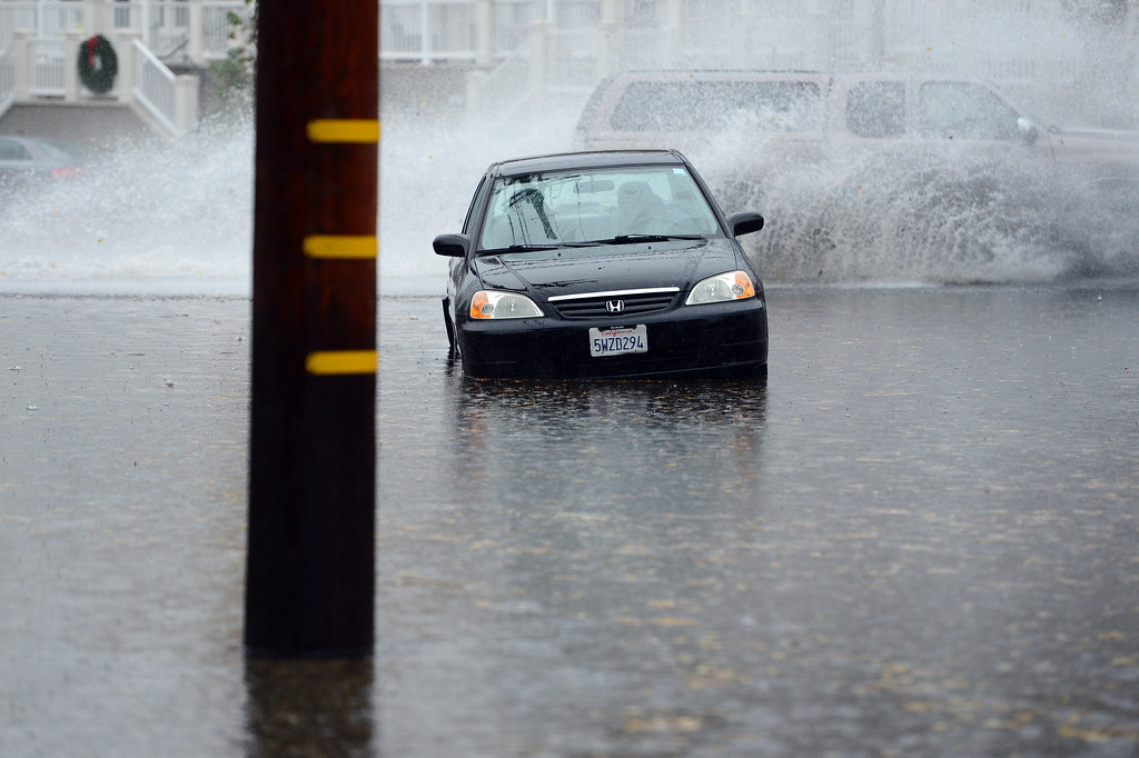 . A portion of W. Julian has turned into a lake due to heavy rains in San Jose, Calif., on Thursday, Dec. 11, 2014. The big storm made it way south, after pounding the North Bay in the early morning hours. (Dan Honda/Bay Area News Group)