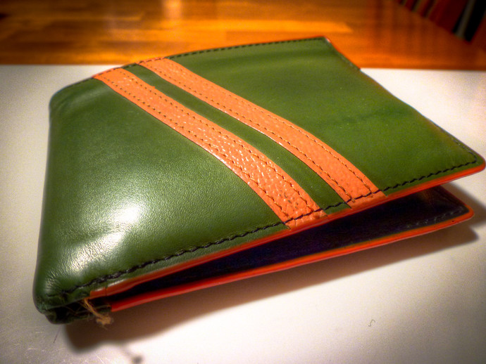 green and orange jfold wallet
