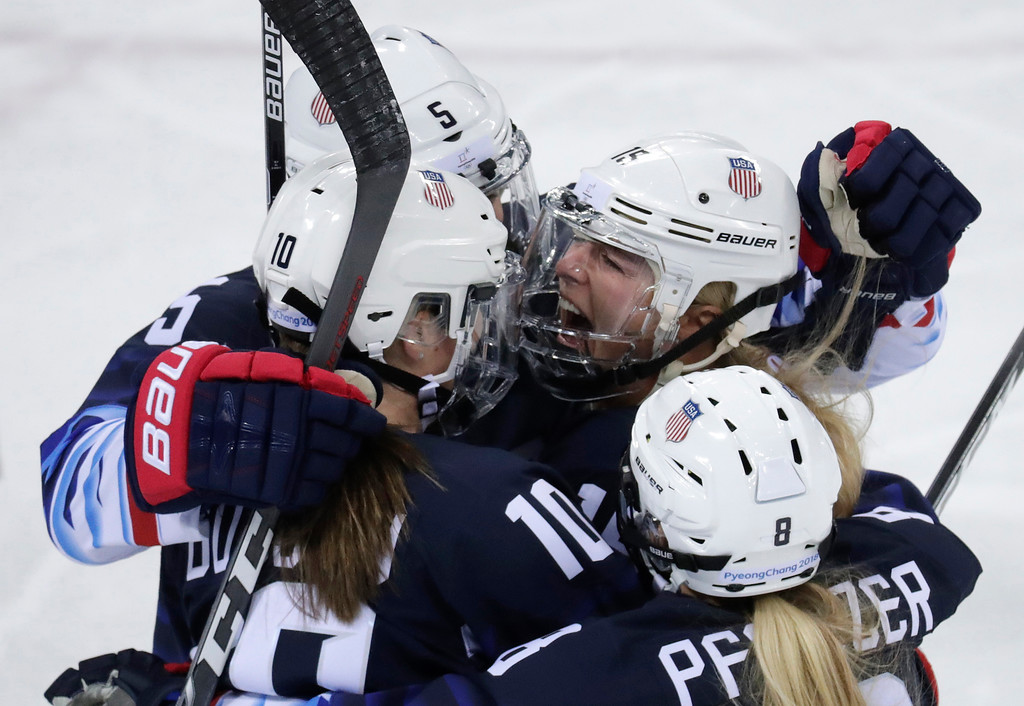 . Gigi Marvin (19), of the United States, celebrates with her teammates after scoring a goal against Finland during the first period of the semifinal round of the women\'s hockey game at the 2018 Winter Olympics in Gangneung, South Korea, Monday, Feb. 19, 2018. (AP Photo/Julio Cortez)