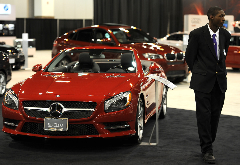". DENVER, CO- MARCH 19: Terrell Travis stands guard over the 2013 SL 550 Roadster Mercedes-Benz on the floor of the Denver Auto Show.  The Denver Auto Show is scheduled to opens Wednesday so preparation for the show is in full swing on March 19, 2013.  The show, which is at the Denver Convention Center, will run through the weekend.  The auto industry is putting renewed emphasis on natural gas-powered vehicles. The low prices of natural gas makes them an attractive option, especially for fleet operators. But a dearth of fueling stations. Also of interest at the show is the new prevalence of luxury cars such as Mercedes offering  ""affordable luxury\' models such as the Mercedes-Benz CLA, starting at $29,900. (Photo By Helen H. Richardson/ The Denver Post)"