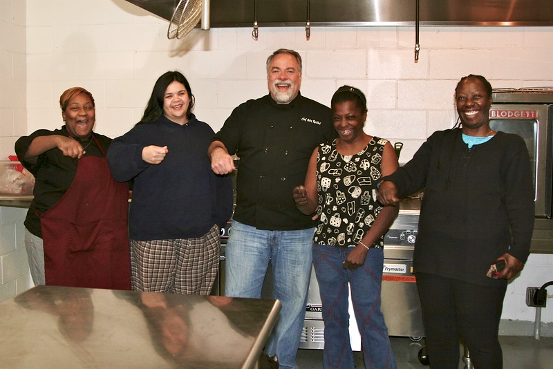 2-7- Chef Alex and some of the pupils in his cooking class at The Gardens.  Alex is helping these homeless ladies develop a marketable skill with a weekly class in the Garden's new industrial kitchen.jpg