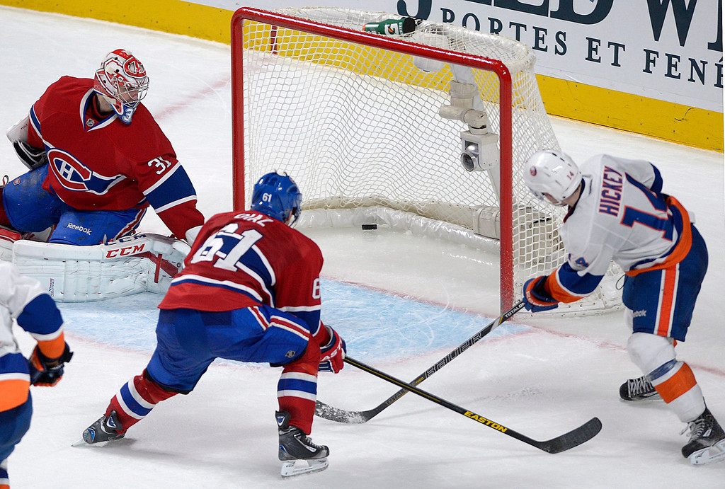 . Montreal Canadiens goaltender Carey Price (31) is scored on by New York Islanders\' Thomas Hickey, right, as Canadiens\' Raphael Diaz defends during overtime of their NHL hockey game, Thursday, Feb. 21, 2013, in Montreal. The Islanders won 4-3. (AP Photo/The Canadian Press, Graham Hughes)