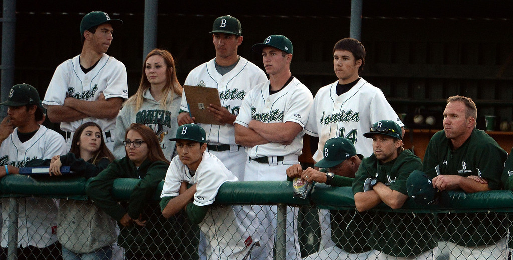 . Bonita bench looks on as San Dimas scores in the second inning of a prep baseball game at Bonita High School in La Verne, Calif., on Wednesday, March 19, 2014.  (Keith Birmingham Pasadena Star-News)