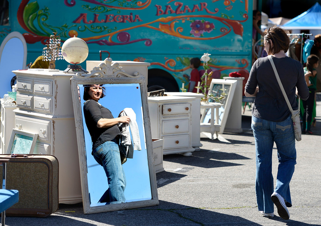 . A woman walks past vintage furniture for sale. Taft High School opened a full-scale Antiques and Collectibles Mart that occur every Saturday in the school parking lot. The school will receive a portion of the proceeds that is not funneled through and picked over by LAUSD. Los Angeles, CA. March 15, 2014 (Photo by John McCoy / Los Angeles Daily News)