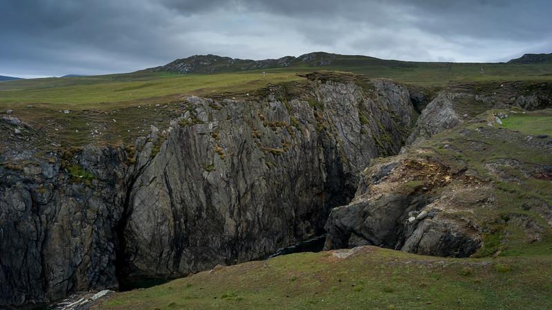 Person standing near cliff, Achill Island, County Mayo, Ireland