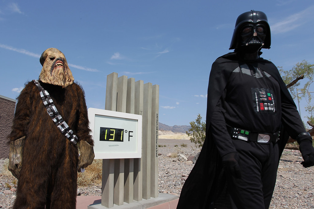 . Randy Kern (L) and John Rice dress as Star Wars characters for their own annual snapshot tradition near an unofficial thermometer at Furnace Creek Visitors Center reading of 131 degrees, believed by officials to be about three degrees on the high side, as a heat wave spreads across the American West   (Photo by David McNew/Getty Images)