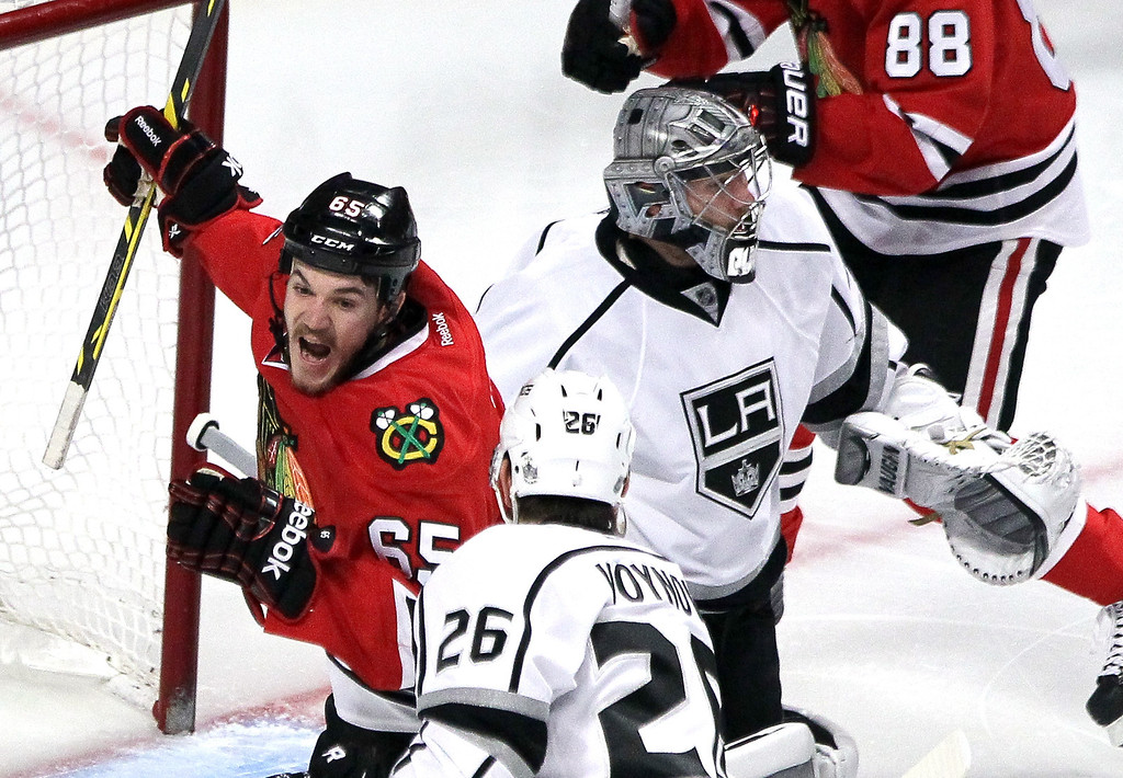 . Andrew Shaw #65 of the Chicago Blackhawks celebrates teammate Brent Seabrook #7 goal on Jonathan Quick #32 of the Los Angeles Kings in the first period during Game Five of the Western Conference Final in the 2014 Stanley Cup Playoffs at United Center on May 28, 2014 in Chicago, Illinois.  (Photo by Tasos Katopodis/Getty Images)
