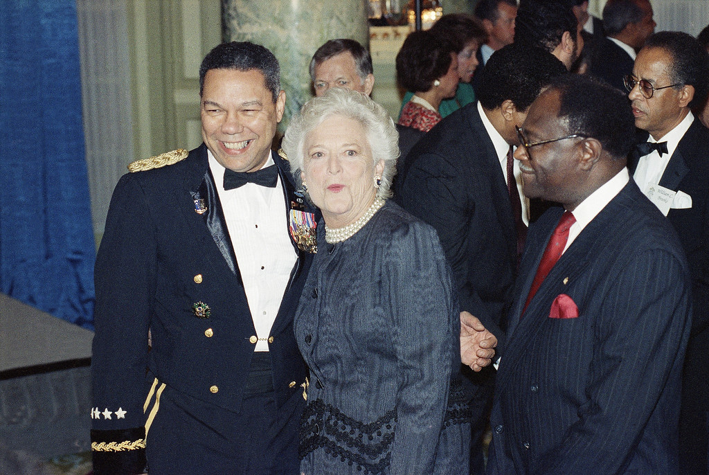 . First lady Barbara Bush poses with chairman of the Joint Chiefs of Staff Gen. Colin Powell, during a reception in Washington, Sept. 18, 1990. The reception is to honor President Bush\'s black appointees to his administration. (AP Photo/Dennis Cook)
