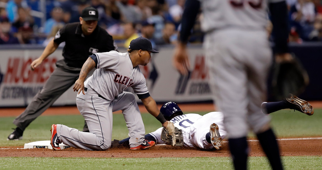 . Cleveland Indians third baseman Jose Ramirez (11) tags out Tampa Bay Rays\' Mallex Smith at third on a stolen base attempt during the fourth inning of a baseball game Monday, Sept. 10, 2018, in St. Petersburg, Fla. Making the call is umpire Scott Barry. (AP Photo/Chris O\'Meara)